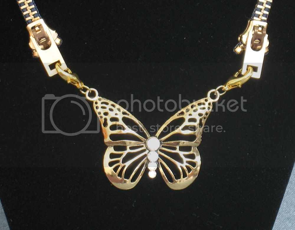 http://img.coplusk.net/originals/0009/5694/Navy_Zip_Butterfly_Necklace_2_1260220025.jpg