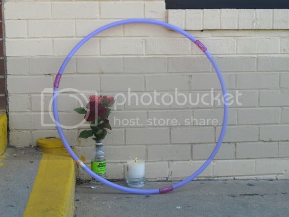 Hoola hoop, flowers and candle